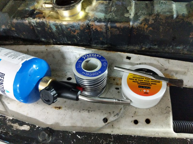 Tools used to braze the filler neck on the radiator.