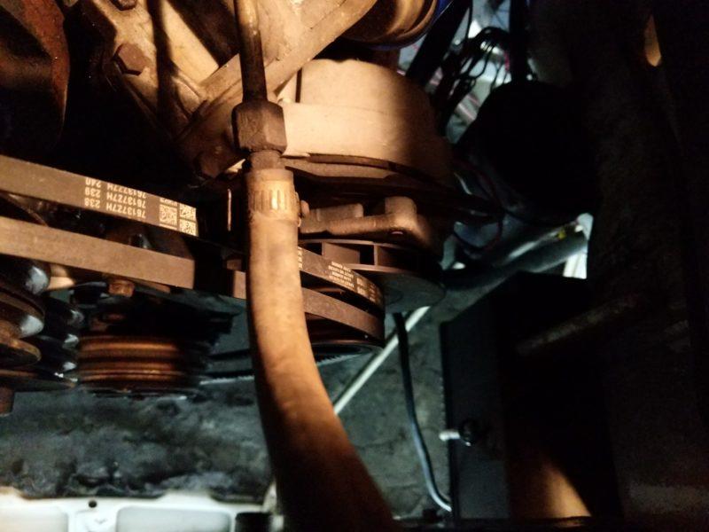 Bolt that adjusts the tension on the alternator belts.