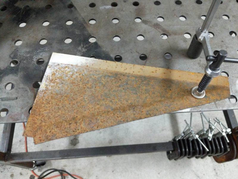 Cardboard template transferred into steel.