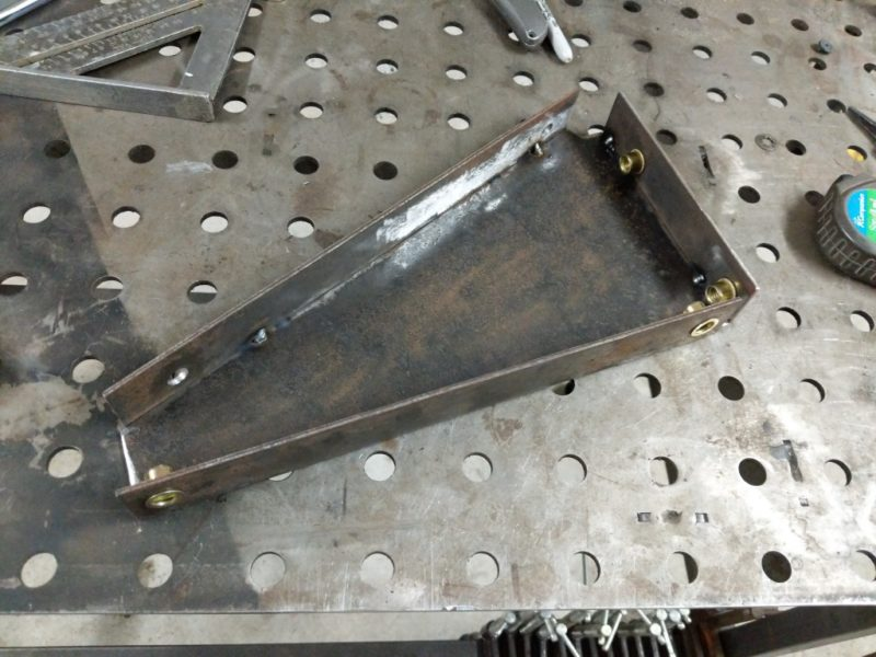 Brackets tacked to the steel triangle.