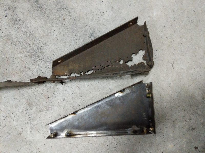 Comparing the original rusted bracket to the new one.